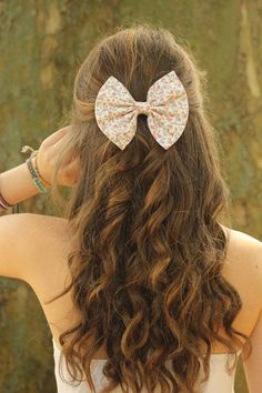 Keep things simple with the help of a cute accessory - bows are perfect for girly-girls who want to add some playful fun to their big-day style.