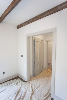 The walls throughout the house are painted White Dove (flat) and the trim is painted Revere Pewter (semi gloss). The floor is stained Jacobean by Minwax.