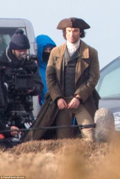 Shackled: Aidan Turner reprised his role as Ross Poldark this week as he was filmed in handcuffs in a windy Cornwall for the new second series of Poldark