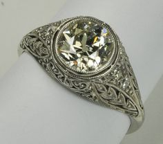 Art Deco Engagement Ring with a 145 center by greenhilljewelers