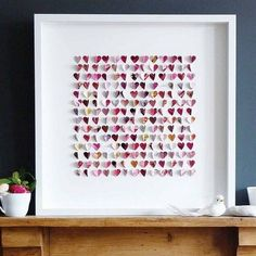 Paper hearts in a shadowbox!  You could make butterflies or snowflakes, too!