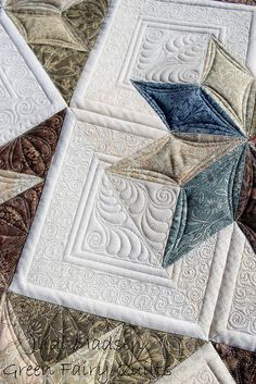 This quilt top and the quilting are simply awe inspiring and amazing! Green Fairy Quilts