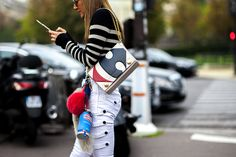 Anna Dello Russo wearing Isabel Marant outfit and Anya Hindmarch bags after a show at Paris Fashion Week
