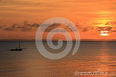 Photo about Silhouette of fishing boat at sunrise - Inhassoro - Mozambique. Image of travel, landscape, exotic - 53541616 Fishing Boats, Sunrise, Exotic, Silhouette, Celestial, Stock Photos, Landscape, Travel, Outdoor