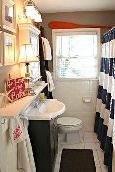 Loving the shelf above the sink and towel hooks next to it. Ladder for towel. Such good ideas for a small bathroom.