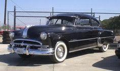 We had a 1949 PONTIAC like this, navy blue, no visor.