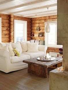 I love the white couch with the natural wood walls and the painted ceiling!