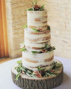 Semi naked cake with olive branch and figs.  At Kingscote Barn