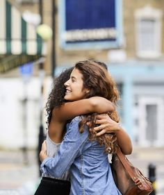 2 women hugging | Shasta Nelson, the author of Friendships Don't Just Happen! and the founder of GirlFriendCircles.com, a women's friendship matching site, shares some realistic advice. (And, yes, it is awkward for everyone.)