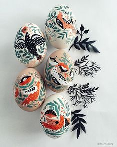 intricately folky painted porcelain eggs