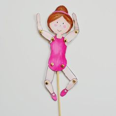 Color in and make your own ballerina puppet with this free printable.