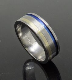 Kathleen Kumskov knows all is possible for a man's Wedding Ring from Peter Kumskov 'My Own Jeweller Direct' in Runcorn, with this Titanium Wedding Ring with Yellow Gold inlay and Blue Titanium finish on the opposite side