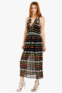 Aztec Ride Dress-Aztec printed midi dress. Features a V neckline and cutouts in the front and back. Stretch band at waist. Partially lined.