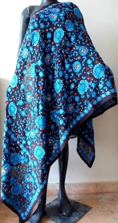 This gorgeous black & blue phulkari work georgette dupatta has a unique color combination, and heavy embroidery. It has been han embroidered in a vibrant colored floral pattern, with wool thread and sequins - See more at: http://giftpiper.com/Handembroidered-Phulkari-Work-Georgette-Dupatta-Black-Blue-id-320577.html#sthash.PyFuQRn2.dpuf