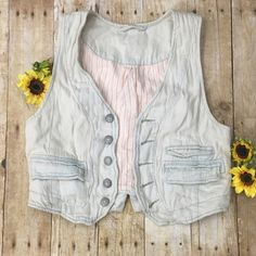 "Free people light denim vest This is new never worn still has extra button attached in bag on vest- super cute for summer! With a tank and shorts 32"" across bottom Free People Jackets & Coats Vests"