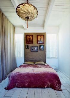 Deep fuchsia velvet bedspread and eclectically gorgeous light fixture