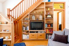 Beautiful entertainment centers for flat screen tvs in Family Room Eclectic with Under Stair Storage next to Built In Entertainment Center alongside Wood Stair Railing and Hidden Flat Screen Tvvolume