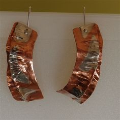 Unique handmade earrings with fold form copper embedded with sterling silver..  $85