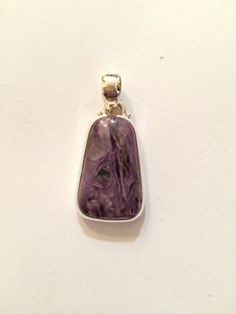 A personal favorite from my Etsy shop https://www.etsy.com/listing/219400851/charoite-pendant-healing-crystal