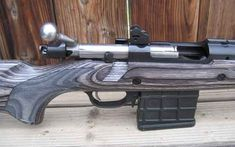Ruger 308 Scout Rifle.  Bolt action featuring a Mauser style claw extractor.