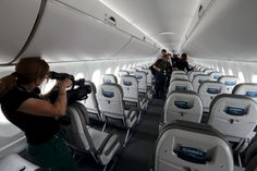 Journalists visit the cabin of the Bombardier CS100 aircraft after a news conference one day before the opening of the 51st Paris Air Show at Le Bourget airport