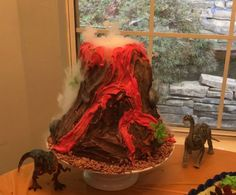 Dry Ice Volcano Cake made out of Rice Crispy Treats and Icing. Coco Krispy cereal and plastic Dino's/Tree/Rocks for decorations   Easy easy easy to make