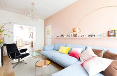 Pastel walls and soft blue sofa in feminine living room