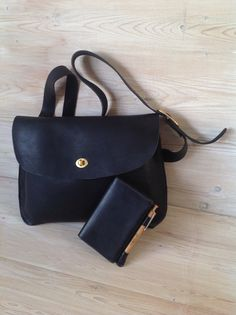 Leather jenny bag and black notebook cover by wolfram Lohr
