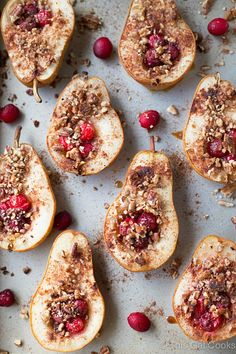 Baked Pears with Honey, Cranberries and Pecans by thisgalcooks: A super simple and healthy dessert recipe. These delicious pears are seasoned with cinnamon and nutmeg for an extra boost of guilt free flavor! #Pears #Honey #Cranberries #Pecans #Healthy