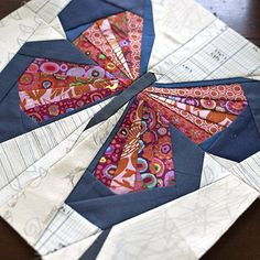 Machine paper piecing a butterfly quilt block using low volume scraps for the…