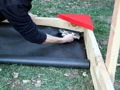 The experts at DIYNetwork.com provide instructions for building a sandbox with a roof.