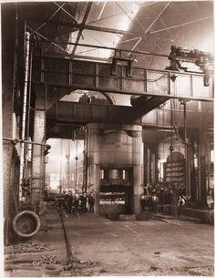 Gelatin printing out paper print, mounted on board of workers posing near a 10,000-ton forging press at Carnegie Steel Companys Homestead Steel Works.