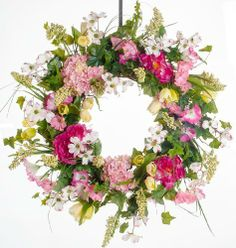 """Peony, Pentunia, and Dogwood Wreath 28"""" by Darby Creek Trading. $179.00. Perfect for Front Door, Wall or over a mantel. Indoor or Outdoor Use. All natural grapevine base with fine imported silk floral. Made-to-Order Designer Silk Wreath. Designed and Created in USA - Powell, OH. Ivy, peonies, petunia, dogwood, tulips, berries and other varieties of flroal has this spring wreath blooming with lots floral.  The picture does not do this wreath justice. Set on a wall,..."""