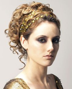 I like this updo with the jewel headband. I bet I could make one with a string from a beaded curtain haha
