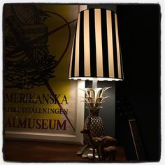 """""""Only ever made one of these #circus #stripe cone lampshades, rather liking it with my awesome #pineapple lamp base...what do you think, should I add this…"""""""