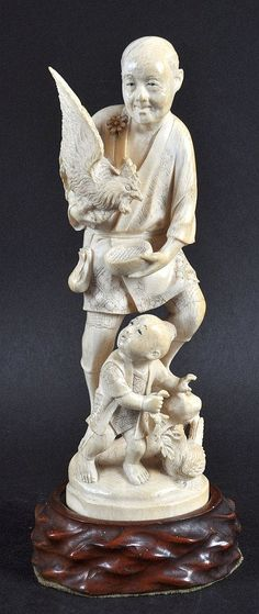 AN EARLY 20TH CENTURY JAPANESE MEIJI PERIOD CARVED IVORY OKIMONO depicting a male holding a hen with child beneath. Signed. Ivory 8.75ins high.