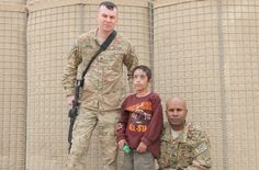 Sgt. Anthony Merino, senior medic for Company B, Task Force 3-66, 172nd Infantry Brigade, and Capt. Giles Wright, Company B commander, pose for a picture at COP Kushamond, Paktika province, Afghanistan, with Matten, an eight-year-old Afghan boy whose face was severely damaged and blinded by an insurgent IED. Merino saved Matten's life, but the insurgent IED blinded him. (by Spc. David Barnes) http://waronterrornews.typepad.com/home/2012/03/us-troops-save-1-of-5-kids-blown-up-by-taliban.html