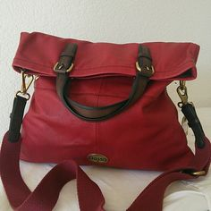 Fossil Explorer Leather Tote Burgundy Fossil Explorer Leather Tote with tag. Soft leather in burgundy has plenty of pockets to keep everything organized. The handbag is large enough to fit all the daily necessities plus tablets and iPads. Fossil Bags Totes