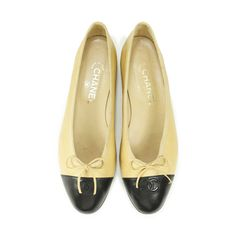 For its understated elegance and ability to dress up any outfit, the Chanel ballerina flats have become a classic must-have. This pair is crafted in beige and black patent coated leather and designed with a ribbon detail and 'CC' logo stitched on the toe. Please note that the shoe has been resoled and there are some creases and minor scuffing on exterior.  | Heel measures 2cm. | Original Retail Price: 675 USD (approx. 962 SGD)