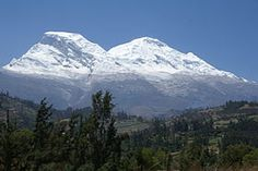 Nevado Huascaran is the highest point in Peru at 22,205 ft (6,768 m) and it's prominence is 9,108 ft (2,776 m).  It is also the highest point in the tropics and the fourth highest point in the Western Hemisphere behind Aconcagua, Ojos del Salado, and Monte Pissis.