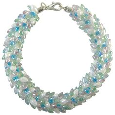 Snow Garden Magatama Beaded Round Kumihimo Braid - 70 (8 gm) of long Magatama beads in the following colors: white pearl ceylon, transparent light lilac, transparent pale green, aqua lined crystal AB