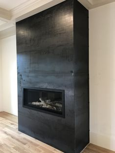 A clean modern look can be applied to your fireplace front. Below is an example of inch hot rolled steel plate applied to the front and sides of a fireplace insert. The metal coloration is. Black Fireplace Surround, Metal Fireplace, Basement Fireplace, Linear Fireplace, Fireplace Built Ins, Concrete Fireplace, Home Fireplace, Living Room With Fireplace, Fireplace Surrounds