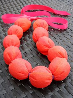 """HOT? Here's a COOLING NECKBAND! Make your own, with love from SnottyDog. (Play nice, and read the creative commons license first, thanks!) The genius of the wraps between the """"beads"""" is that they keep the filler from shifting, which you know is a definite plus if you've ever tried the flat style. How about silk? Handkerchief linen? Thin fancy ribbon?"""