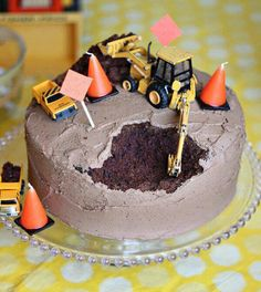 Construction birthday cake: all my cakes look like this. they were just missing construction toys on top!