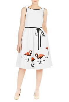 Coral flamingo embroidery patterns the ruched pleat skirt of our feminine poplin dress paired with a contrast, waist-defining tie-belt.
