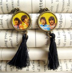Share your impeccable taste in music with the world! These earrings feature an image of the fab four from the Beatles Sergeant Pepper album sealed