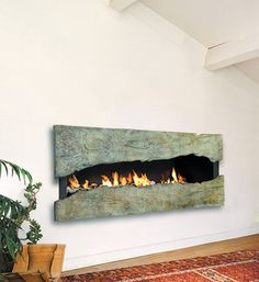 Take a Peek  This green patinaed metal hearth can be open to expose the fire within, or closed to give just a glimpse. The creative crevice looks beautiful even when the fire isn't lit.