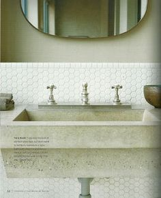 wall-mount concrete sink / white hexagonal tile