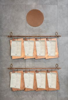 These menus on copper clipboards are hung on a copper pipe attached to the wall of a restaurant in Valencia. Porte Menu Restaurant, Menu Restaurant Design, Plan Restaurant, Architecture Restaurant, Restaurant Branding, Copper Restaurant, Restaurant Order, Cafe Design, Store Design