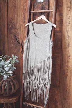Long Tunic Top with fringe detail that is approximately knee length. COLOR: Grey/Sage